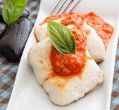 Fish on sauce — Stock Photo
