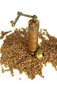 Old hand mill with coffee beans — Stockfoto