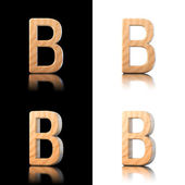 Three dimensional wooden letter B. Isolated on white and black. — Stock Photo