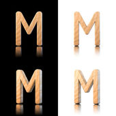 Three dimensional wooden letter M. Isolated on white and black. — Stock Photo