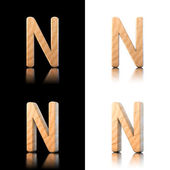 Three dimensional wooden letter N. Isolated on white and black. — Stock Photo