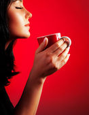 Beautiful lady drinking coffee — Stock Photo