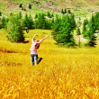 Girl jumping on wheat field — Stock Photo #12489691