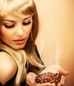 Girl hold coffee beans — Stock Photo