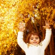 Autumn game of little girl — Stock Photo