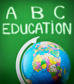 Globe in classroom — Stock Photo