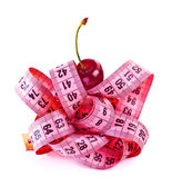 Measure tape with cherry — Stock Photo