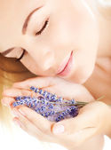Beautiful girl smell lavender flowers — Stock Photo