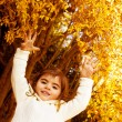 Baby girl in autumn park — Stock Photo