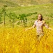 Woman on wheat field — Stock Photo #12819022