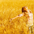 Happy woman on wheat field — Stock Photo #12819128