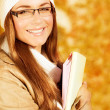 Stock Photo: Cheerful student girl