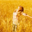 Female on wheat field — Stock Photo