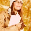 Happy student girl in autumn park — Stock Photo
