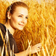 Woman on wheat field — Stock Photo #12819951