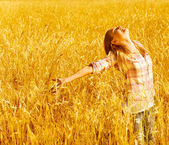 Happy woman on wheat field — Stok fotoğraf
