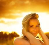 Beautiful female over sunset — Stock Photo