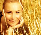 Beautiful female on wheat field — Stock Photo