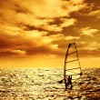 Silhouette windsurfer over sunset — Stock Photo #12820041