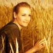 Pretty female on wheat field — Stock Photo