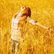 Girl on autumn wheat field — Stock Photo