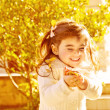 Happy little girl in autumn park — Foto Stock