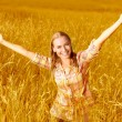 Cheerful girl on wheat field — Stock Photo