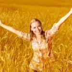 Cheerful girl on wheat field — Stock Photo