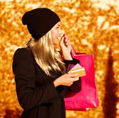 Girl with shopping bag — Stock Photo