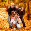 Lovely family in park — Stock Photo #13683777