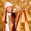 Stylish woman with purchase bags — Stock Photo