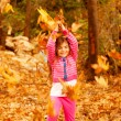 Cheerful girl in park - Stock fotografie