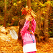 Adorable girl in autumn woods - Stock Photo