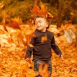 Cute child in autumn forest — Stock Photo