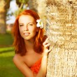 Pretty woman in tropical nature - Stok fotoraf
