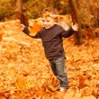 Stock Photo: Small boy running in forest