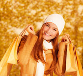 Cheerful woman with paper bags — Stock Photo