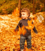 Baby boy in fall backyard — Stock Photo