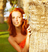 Pretty woman in tropical nature — Stock Photo