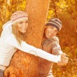 Happy couple in autumn park — Stock Photo