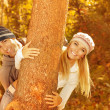 Stock Photo: Young family in the wood