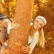 Young family in the wood — Stock Photo #13848708