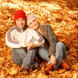 Foto Stock: Happy family in autumn park