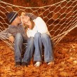 Happy couple in hammock — Stock Photo
