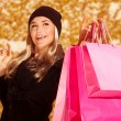 Happy female with presents bags — Stock Photo