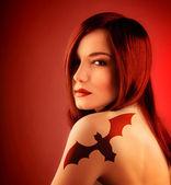 Girl with bat tatoo — Stock Photo
