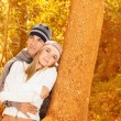 Happy lovers in autumn park — Stock Photo