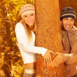 Happy lovers in autumn forest — Stock Photo