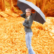 Lovely woman under umbrella — Stock Photo