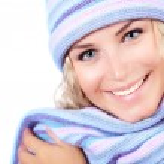 Happy girl in winter hat — Stock Photo #14031396